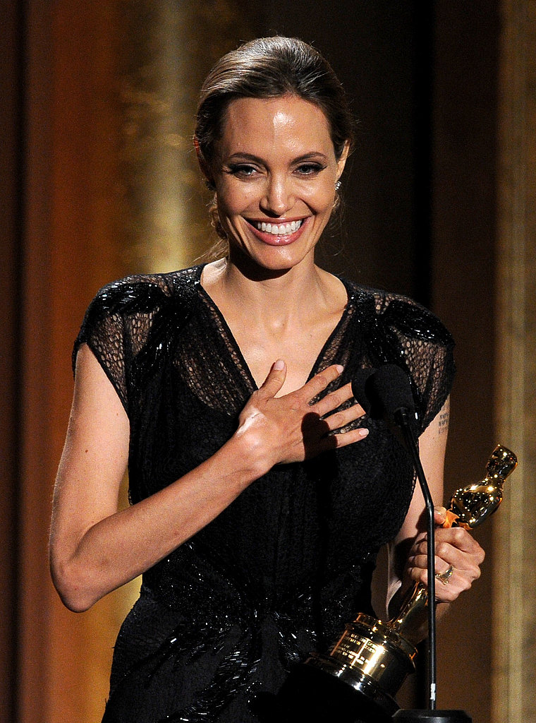 Angelina Jolie glowed while accepting the award for her humanitarian work, thanking Brad Pitt for his support.