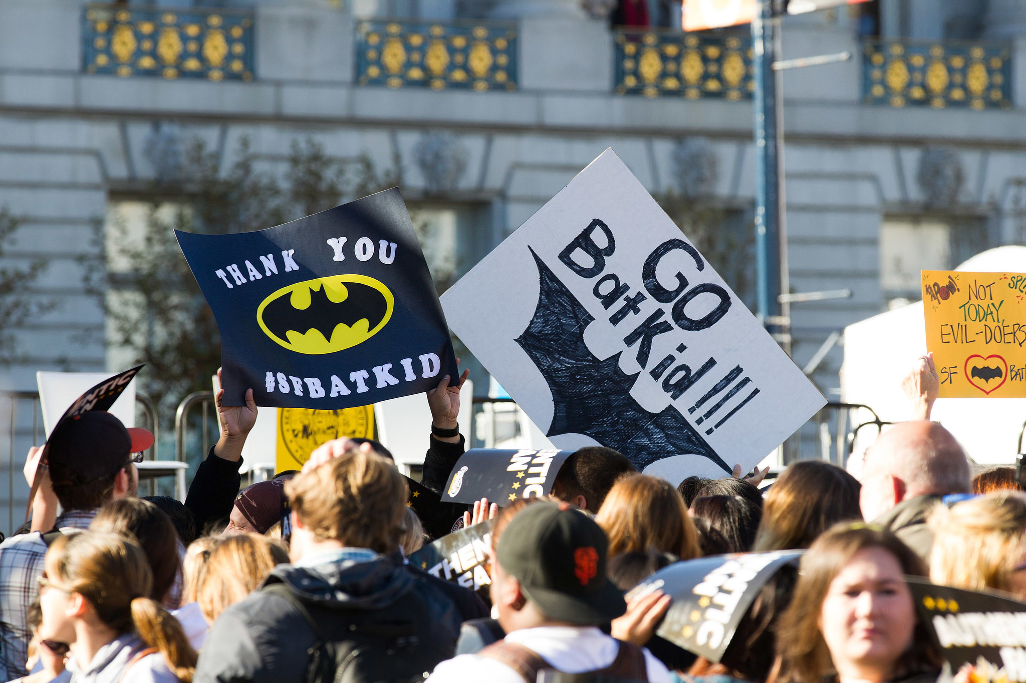 Signs for Batkid filled the crowd, which cheered