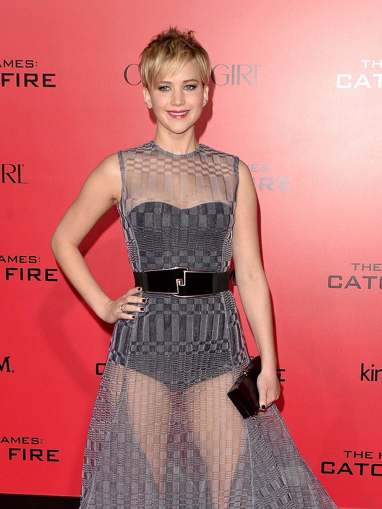 Jennifer Lawrence wore a gray dress with a sheer, belted overlay.