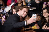 Liam Hemsworth took a snap with fans.