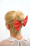 Sometimes, all you need is a red and gold silk hair bow ($55).