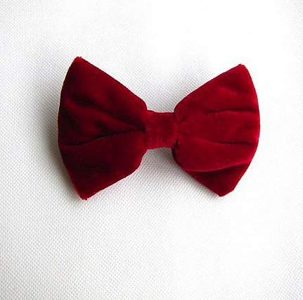 Nothing says holiday cheer quite like a little red velvet bow clip ($5).