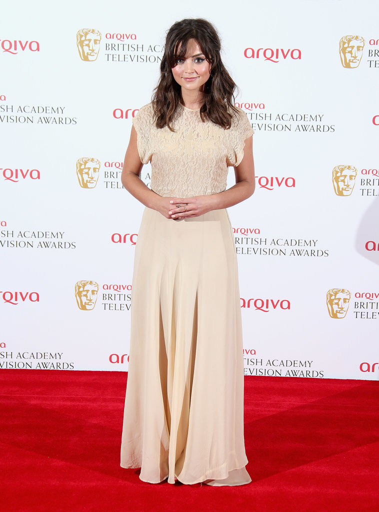 Another lace trim appeared on Jenna's vintage-style gown for the BAFTA Television Awards in 2013.