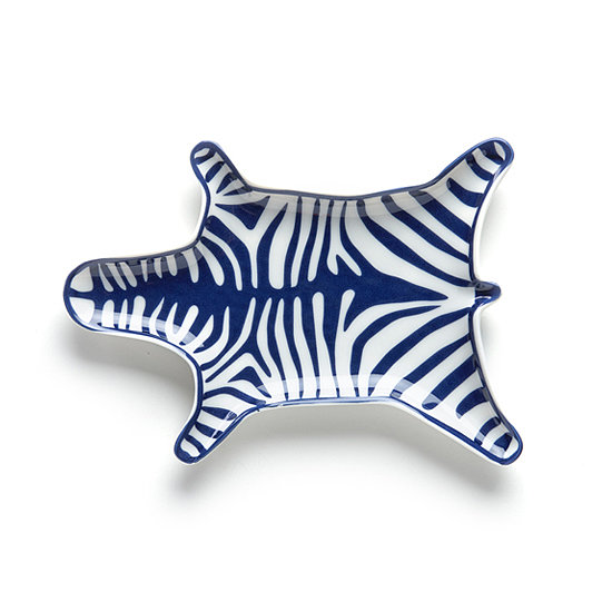 Jonathan Adler Carnaby Zebra Stacking Dish Nothing says signature Jonathan Adler like bringing a sense of humor into design. Place this playful, modern tray next to your bed or on an entryway table to catch valuables and bring a pop of animal print to the decor. *Color may vary.