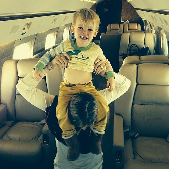 Luca Comrie had the whole plane to himself, but chose the most fun seat — Hilary Duff's shoulders. Source: Instagram user hilaryduff