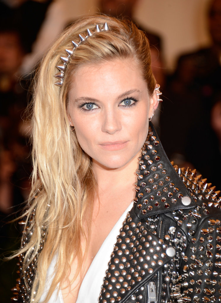 At the punk-themed Met Gala, Sienna Miller got into the spirit of the evening with her studded headband and mock undercut.