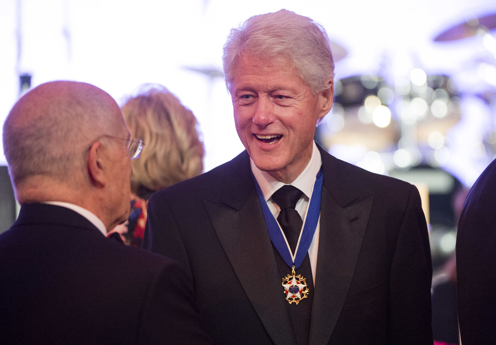 Bill Clinton was all smiles at the gala later that night, chatting with other guests.