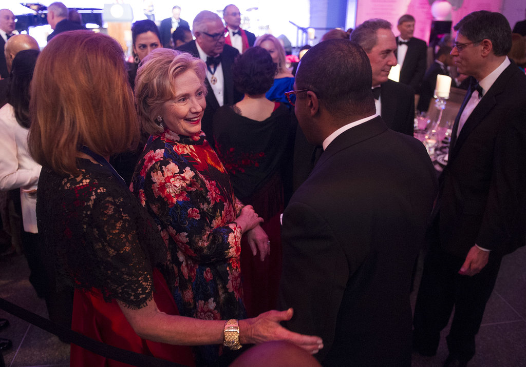 Former Secretary of State Hillary Clinton mingled with guests at the dinner honoring Presidential Medal of Freedom recipients, which included her husband, Bill Clinton.