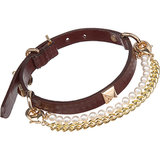 "Staying true to the brand's, well, human, collection, this Fallon cordovan dog collar ($170) comes complete with studded hardware and two detachable ""necklaces,"" a gold-plated biker chain and Swarovski pearls that can be mixed and matched – the perfect gift for the pet who hasn't quite developed its signature street style look just yet."