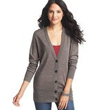 Keeping a go-with-anything sweater, like this LOFT Boyfriend Cardigan ($50), on hand is always a good idea.