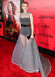 Is it just us, or was Jennifer Lawrence's Dior Haute Couture gray knitted evening dress reminiscent of grosgrain ribbon? Her sleek Roger Vivier box clutch and satin Brian Atwood sandals were the perfect counterpoint to her textured gown at the LA Catching Fire premiere.