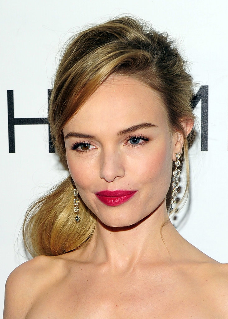 Looking festive is easy. Take a styling cue from Kate Bosworth, and try a voluminous side ponytail paired with a bold berry lipstick.