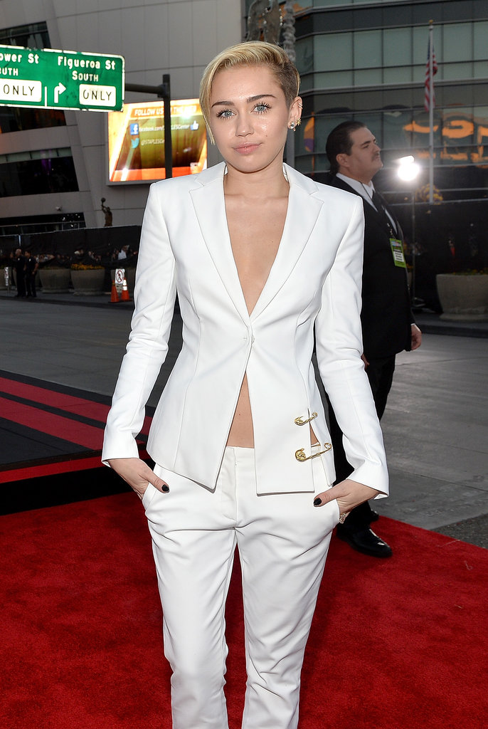 Miley Cyrus wore a white suit to the American Music Awards.