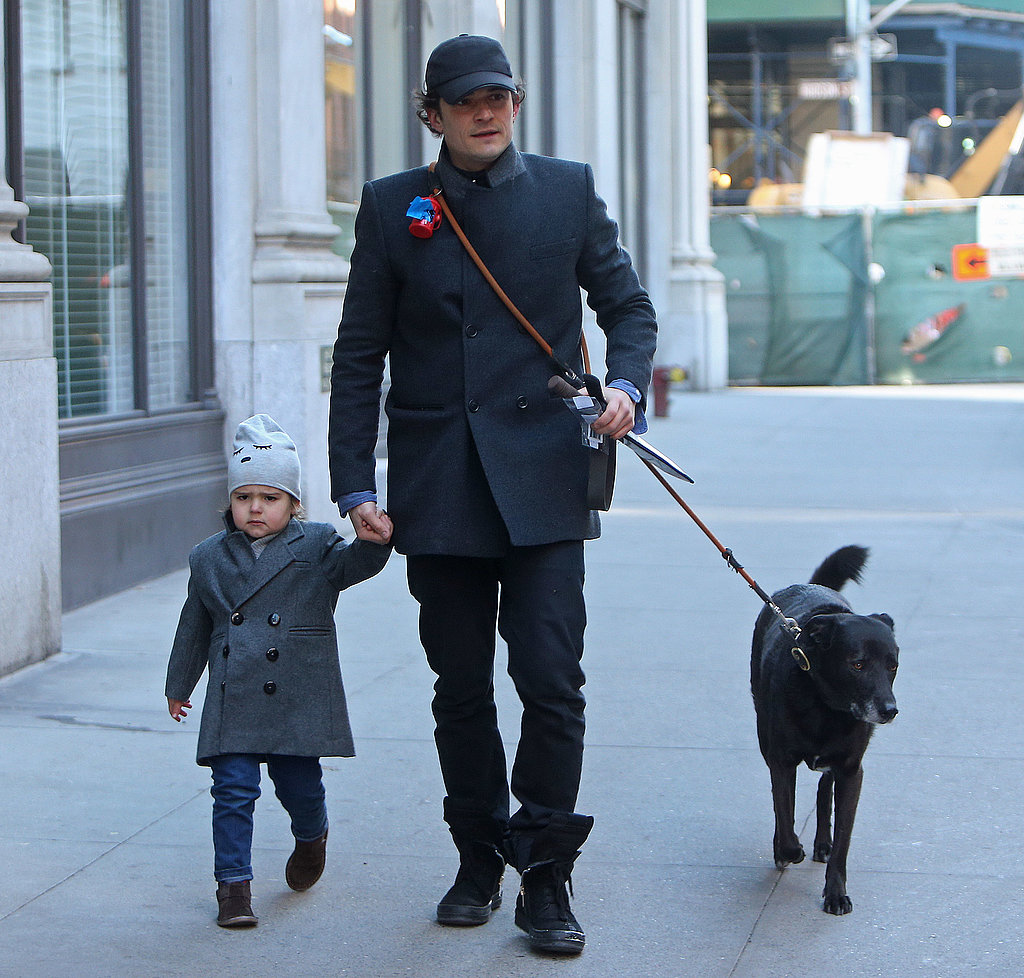 Flynn didn't seem thrilled while walking with Orlando and dog Sidi in NYC in November 2013.