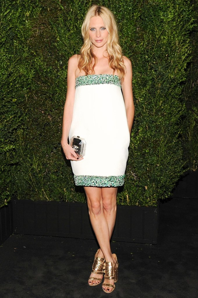 The bes way to put out the holiday vibe? A great pair of gold heels a la Poppy Delevingne.