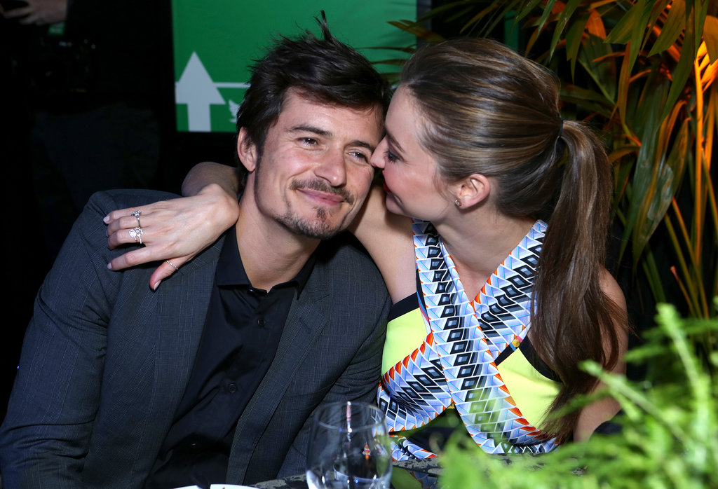 Miranda Kerr nuzzled with Orlando Bloom at an event in Hollywood back in February.