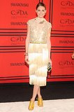 Olivia Palermo's gold top and fringed skirt were made for the holiday season.