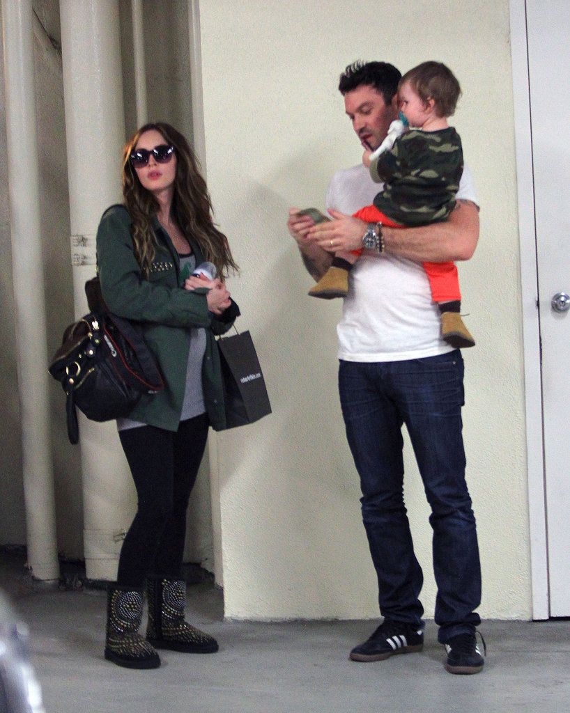 Megan Fox revealed her growing baby bump when she stepped out in LA with Brian Austin Green and little Noah.