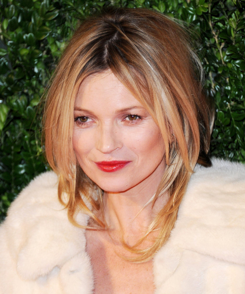 Not one to shy away from sex appeal, Kate Moss wore her hair in a voluminous blowout and finished off her look with glossy red lips.