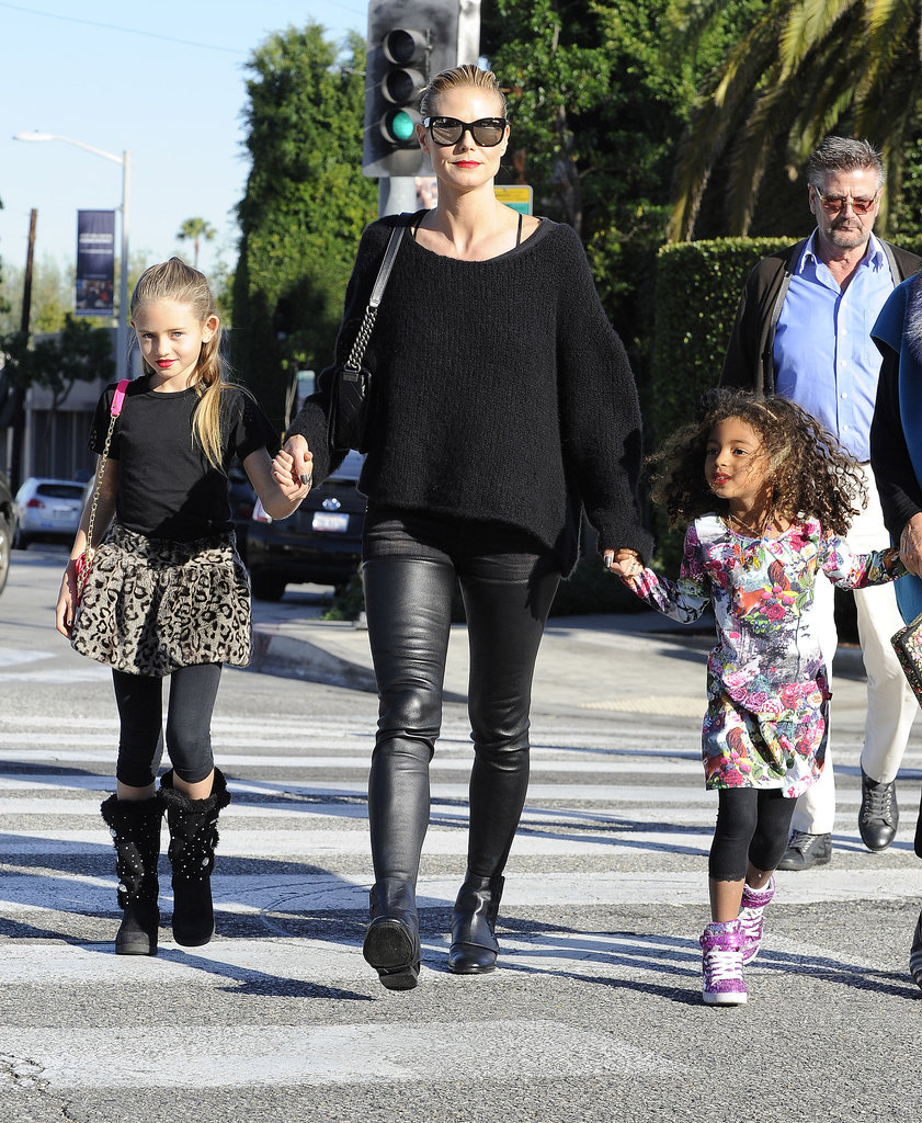 Heidi Klum kept her daughters, Leni and Lou, close for a family outing in LA.