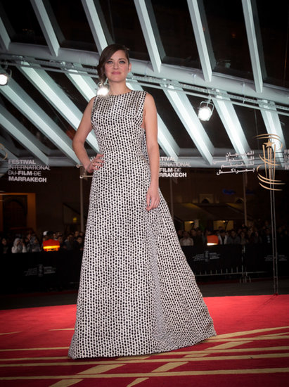 At the Marrakech International Film Festival, Marion Cotillard stole the show in a black and white spotted and pleated Dior Haute Couture gown.