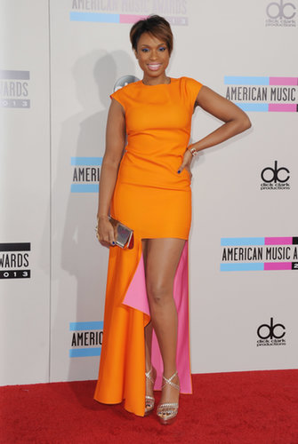 Jennifer Hudson complemented her new pixie cut with this gorgeous bright orange Christian Dior gown at the American Music Awards.