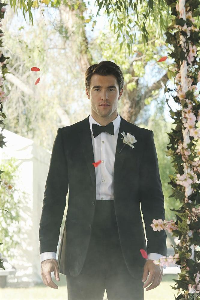 Daniel (Bowman) stands among flower petals.
