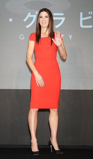 Bullock chose a simple yet amazingly cut red dress for the Gravity press conference in Tokyo.