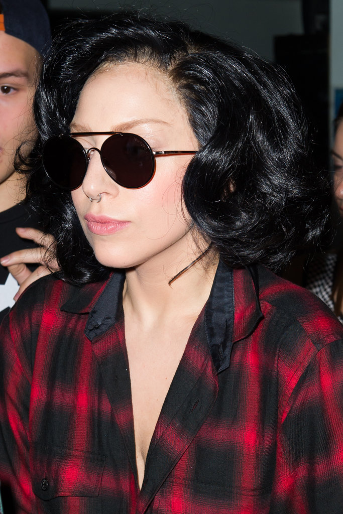 Is this Lady Gaga or Katy Perry? This shoulder-length, jet-black wig and plaid ensemble reminds us of another beauty phenom.