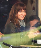 Dakota Johnson flashed her smile on the set of Fifty Shades of Grey in Vancouver on Sunday.