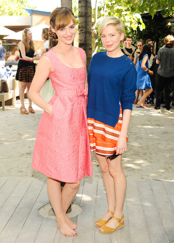Louise Bourgoin and Michelle Williams at Louis Vuitton's beach barbecue.