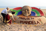 A Nelson Mandela sand sculpture drew attention in India.
