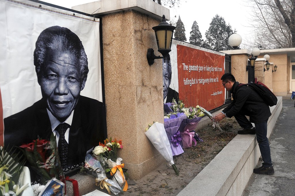 A man in China added a bouquet of flowers to the Nelson Mandela memorial in Beijing.