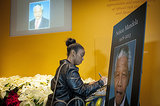 A woman signed a condolence book for Nelson Mandela at The National Museum of African Art in Washington DC.