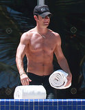 Jennifer Aniston's fiancé, Justin Theroux, hung poolside in Mexico in August.