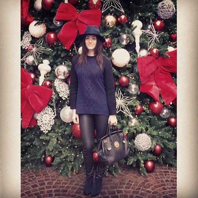 Shameless star Emmy Rossum posed in front of a giant Christmas tree. Source: Instagram user emmyrossum