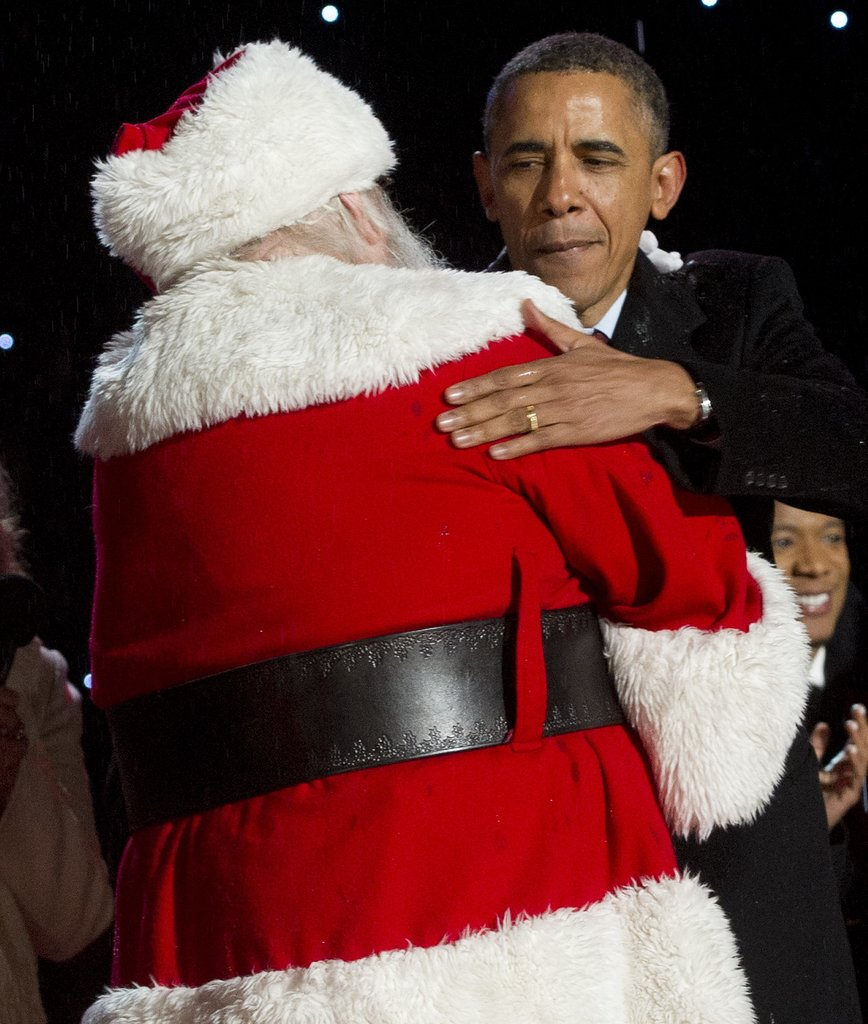 President Obama gave Santa Claus a big hug.