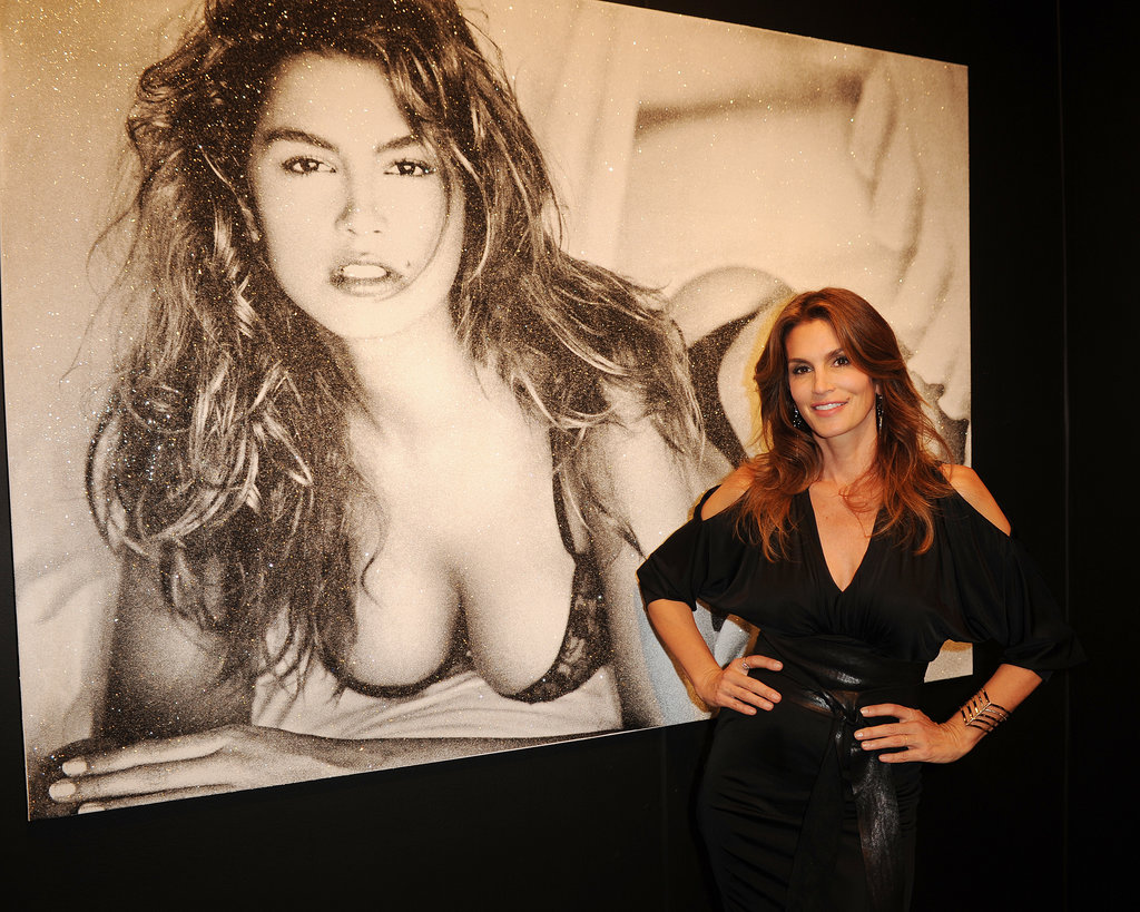 Cindy Crawford posed in front of one of her famous photographs at an Art Basel event in Miami on Tuesday.