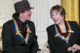 Carlos Santana and Shirley MacLaine chatted on stage at the White House.