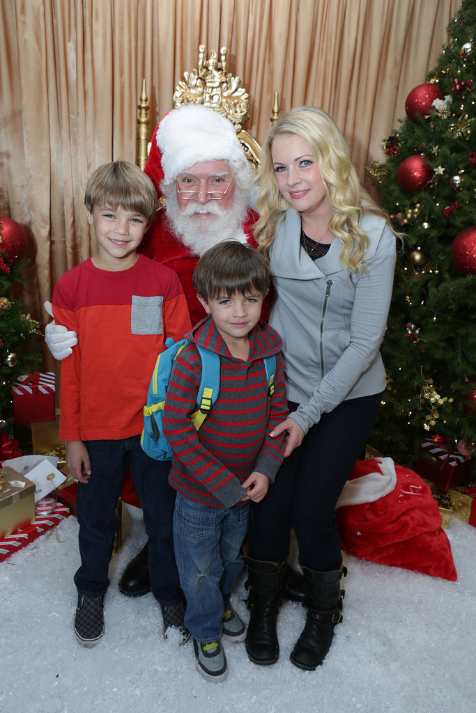 Melissa Joan Hart and her sons Mason and Brady snapped a sweet group shot with Santa at his LA Secret Workshop benefit.