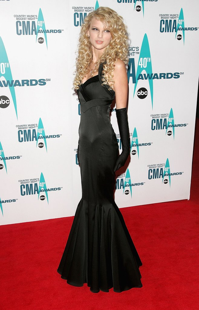 Swift's 2006 body-hugging fishtail gown was a little reminiscent of the sultry Jessica Rabbit — but in true Taylor form, the start sweetened up the look with au naturel curls and high-fashion evening gloves.