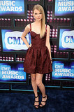 The 2012 CMT Awards brought out a darker side of Taylor, as the star donned a maroon brocade bustier dress and wine-hued strappy sandals.