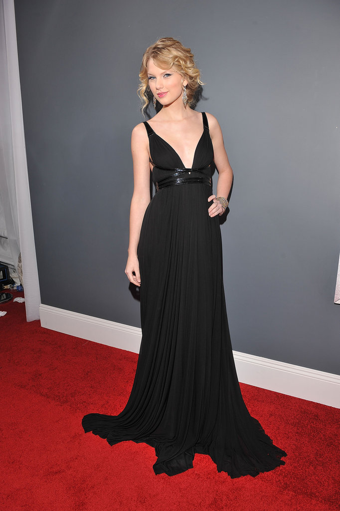 In 2009, Taylor Swift was all about sophistication in a black Grecian-inspired Kaufman Franco gown cinched with a patent leather wrap that added a modern touch.