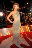 For the 2009 MTV Video Music Awards, Taylor Swift opted for a one-shoulder sequined gown that oozed luxury, especially with that long side train.