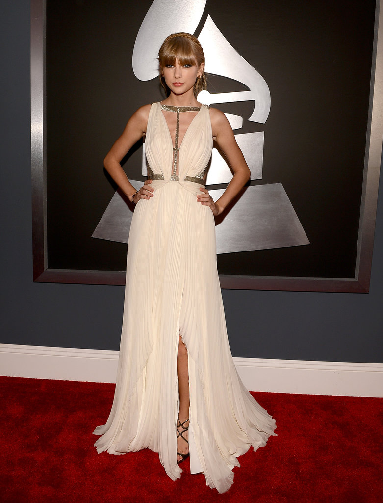 Taylor continued her sexy sophisticate run in a creamy J. Mendel gown, featuring a plunging metallic beaded bodice and accordion-pleated bottom, at the 2013 Grammy Awards.