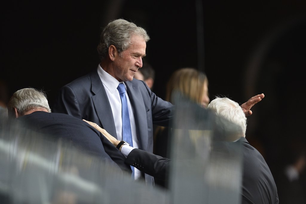 Former President George W. Bush waved to crowds during the memorial.