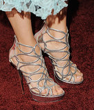 Silver sparkle worked for Nina Dobrev, who picked strappy sandals for a Golden Globe party last January.