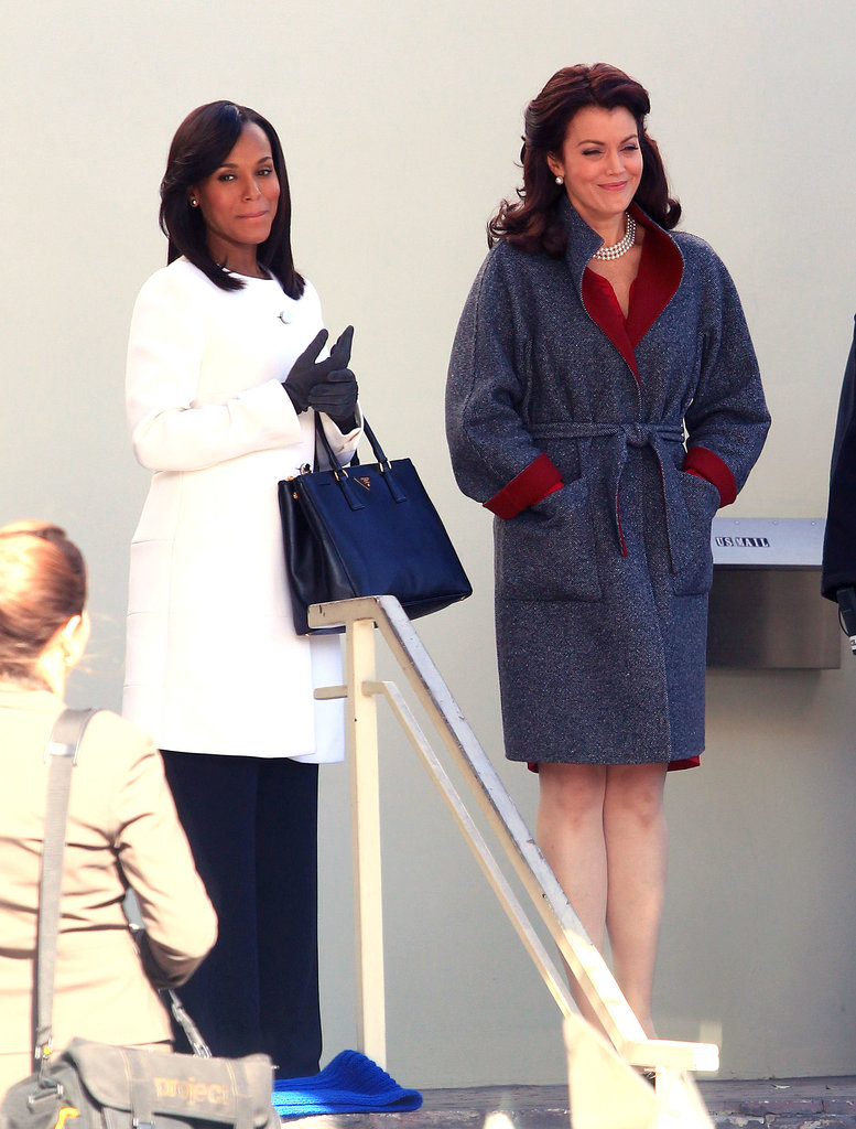 Kerry Washington covered up her growing baby bump in a white coat while filming scenes with Bellamy Young for ABC's Scandal in LA on Monday.