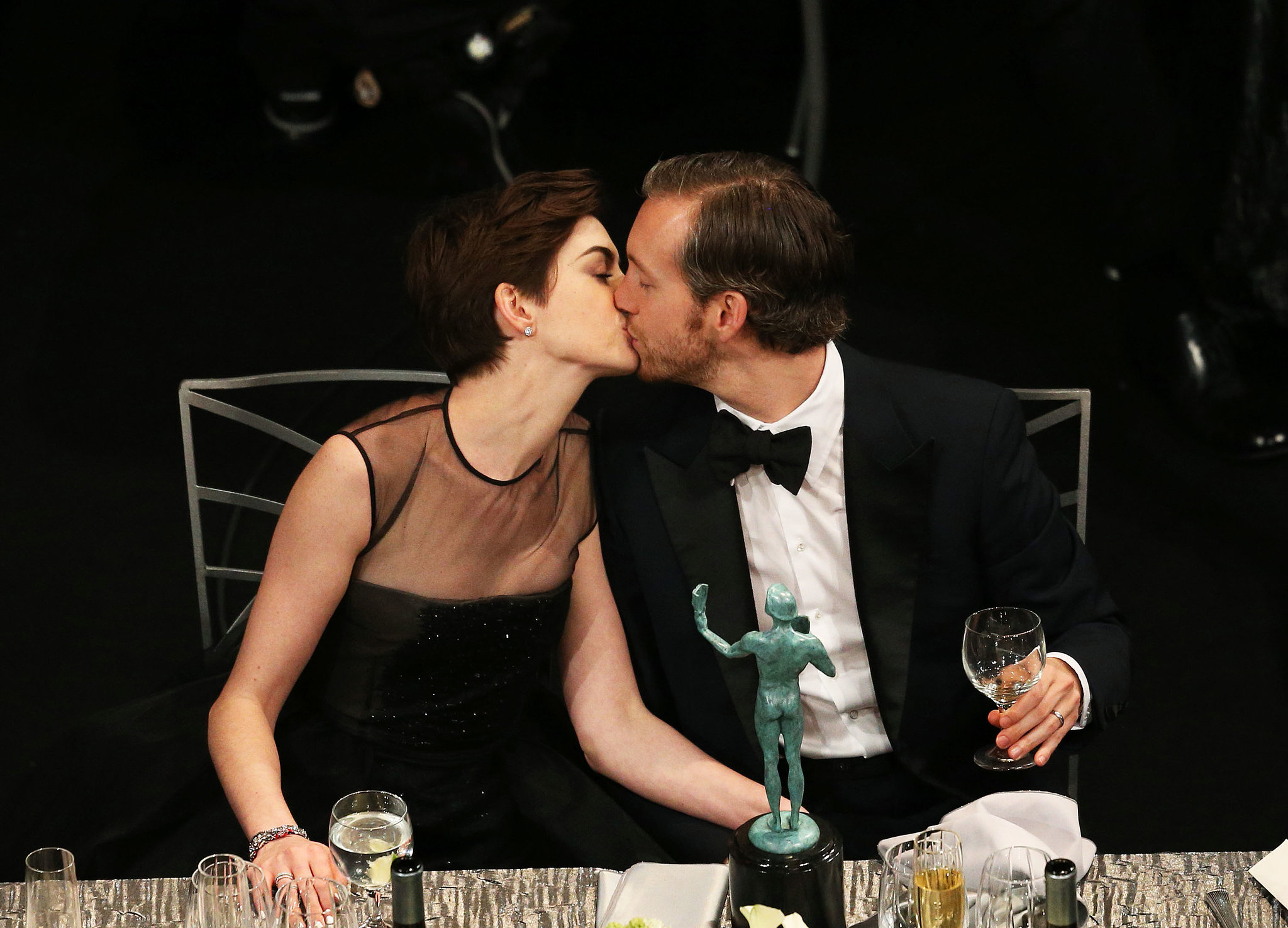 Anne Hathaway kissed husband Adam Shulman after picking up her SAG Award statue.
