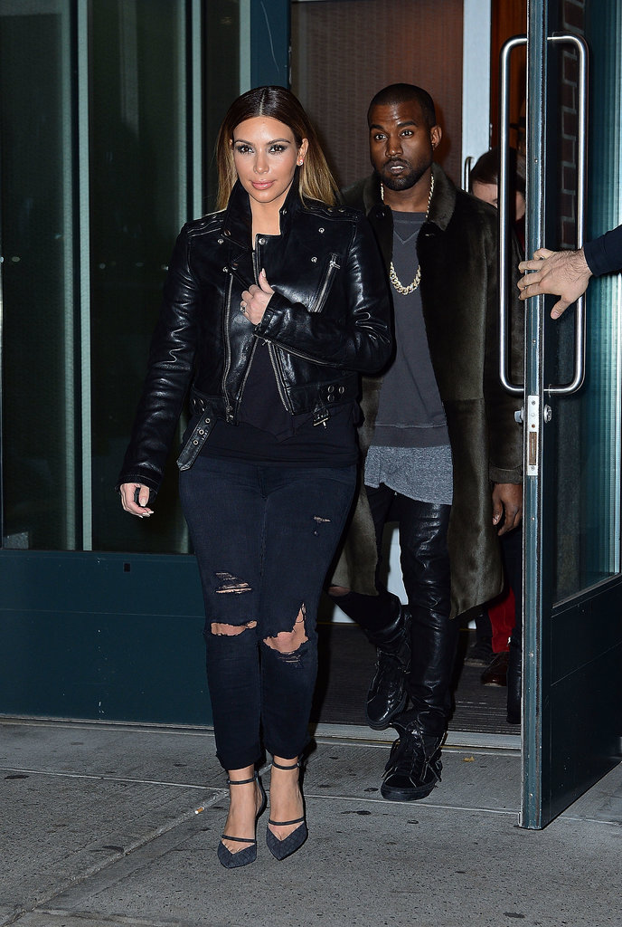 In November, a little torn denim and leather looked fresh and edgy on a casual Kim.
